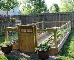 Raised & enclosed garden  [Via Organic Gardening]