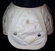 Hip pads and bustle (the only extant I've seen yet!), c.1903. The grommets were, supposedly, to help the padding breathe.