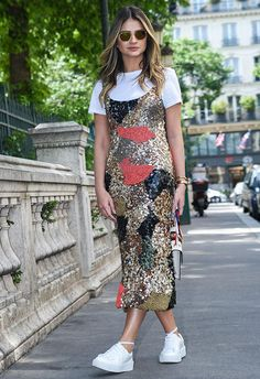 Thássia Naves wearing a sequin cami dress layered over a white tee at fashion week
