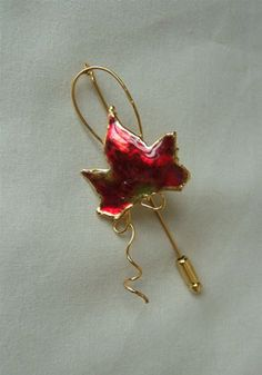 Get it now  Gold Dipped Maple Leaf Pin in Autumn Red http://www.wasandnow.com/shop/gold-dipped-maple-leaf-pin-in-autumn-red/ #Arttowngifts, #Autumn, #Dipped, #Gifts, #Gold, #In, #Jewelry, #Leaf, #Maple, #Pin, #Red, #Specialty Perfect Gifts For the nature lover a miniature autumn red maple leaf has been picked at just the right time and then preserved in lacquer and trimmed with just the right amount of 24K gold to make an autumn red Maple Leaf Pin. This process is the same as