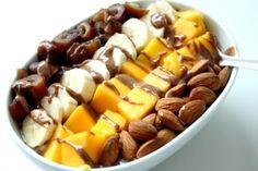 Chia vanilla overnight oats with chopped dates, banana, mango, almonds and almond butter.