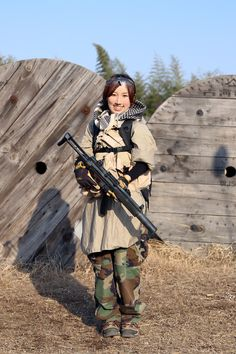 Airsoft Player in Japan. Fashion Photo Woman. Camise and woodland camo pants. #Military #girl #gun #combat