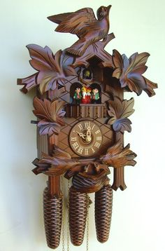 Anton Schneider Feeding Birds Cuckoo Clock, Model #8TMT 176/9. During the call of cuckoo the two birds on the bottom rock to feed the nest. After the call the dancers dance to one of 2 melodies that alternate with each hour. This clock is available at CuckooKingdom.com