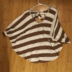 Vava cut-out top! Brown and white striped top by Vava with cutout in back. Ties at the top to keep the top on your shoulders. Size Small. No stains or tears! Vava by Joy Han Tops