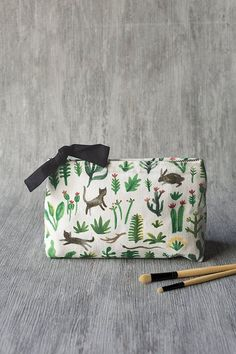 Secret Garden Large Cosmetic Bag - A large cosmetic bag made from 100% linen is perfect for storing your beauty essentials, accessories, toiletries and more. The zipper is complete with a black tie for tactile appeal. Lively illustrations of birds, felines, reptiles and rabbits bound through the underbrush amongst fantastical foliage. Large Cosmetic Bag, Travel Toiletries, Cat Design, Beauty Essentials, Zipper Pouch, Travel Style, Bag Making, Vegan Leather, Travel Bags