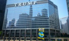 Greenpeace hangs 'resist, defend' banner on Trump Tower in Chicago