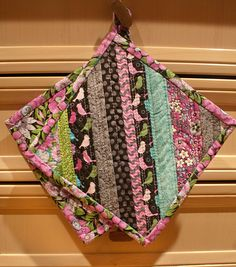 Quilt-as-you-go potholder tutorial from Jo-Ann Fabric.