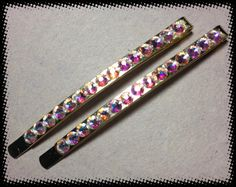 Gold hair clips with Swarovski Crystal AB rhinestones. Shines bright in the light.