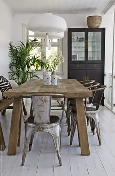 Rustic table and silver Tolix chairs