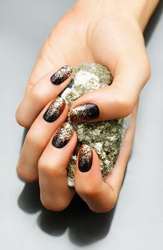 Glittery black and copper nail art