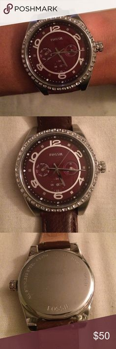 Fossil Burgundy Watch Gorgeous burgundy Fossil chronograph watch. Stainless steel case with burgundy face and straps. Worn roughly 15 times. Minimal wear on the strap, and minor scratches on the case back. Fossil Accessories Watches