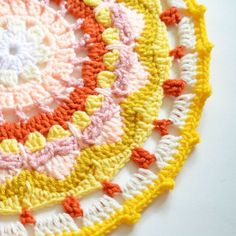 Inspired by the sun, I've created this beautiful crochet mandala to add to my wall art. Find the free pattern on my blog!