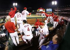 players in the dugout react after Carlos Beltran hit the game-winning single in the bottom of the 13th inning during Game 1 of the NLCS against the Dodgers. 10-11-13