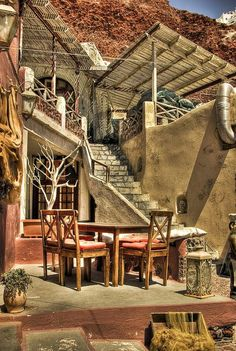 Beautiful cafe in Ammoudi, Oia Santorini by Milos Novakovic