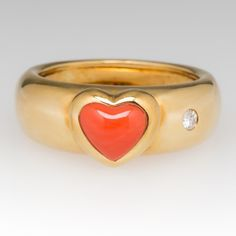 This well designed ring is crafted of weighty yellow gold and features a bezel set pink coral heart and a high quality genuine diamond set to one side. The ring has a makers mark of LAVIN. Turquoise Rings, Turquoise Jewelry, Diamond Bands, Cocktail Rings, Band Rings, 18k Gold, Heart Ring, Jewelry Design, Bling