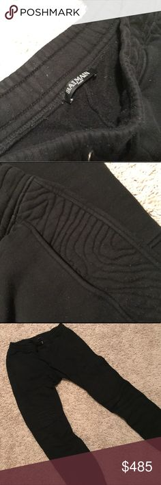 BALMAIN Men's Black Sweat Pants Black Balmain Men's sweats. I bought them in the Paris Balmain store. Modern cut. Slim fit. Detail on the side of the hips down the leg until above the knee. Two pockets on the back.  No stains or rips. Just the normal little fuzz pieces from wearing them. You can see it in the zoomed in photo. I am a girl and they look great when I want the relaxed comfy look. I had them pulled past my ankles in the photo. Balmain Pants Sweatpants & Joggers