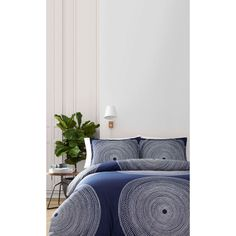 "Feel at home. Let go and sleep in. Fall into a soothing sleep amid the navy Fokus patterned duvet set. Made with 200-thread-count 100% cotton percale material.The twin duvet set measures 86"" x 66"" and includes a duvet cover an"