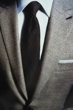 Grey Suit with a wide spread collar and a pocket square. Perfect pairings.