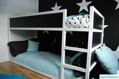 Repaint job on Ikea Kura loft bed. And I kinda love the star wall, too!
