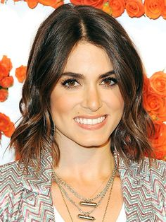 Imperfect curls give actressNikki Reed's chin-length chop some sexy texture. Wrap two-inch sections of mid-shaft hair around a curling iron, keeping ends loose so they fall straight. Finish the look with dry shampoo and tousle ends with your fingers. via @stylelist