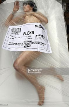 Naked PETA protesters are wrapped in cellophane for a pro-vegetarian demonstration in central London, 17 August 2006. The demonstrators mimicked typical packages of meat and hope to to encourage consumers to give vegetarianism a try.