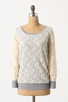 Lace blouse meets cozy sweatshirt. A good choice for bringing your casual weekend wear up a notch. #Anthropologie #lace