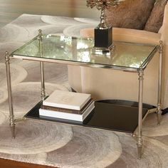 Glass table creates an elegant and delicate look   to the room.
