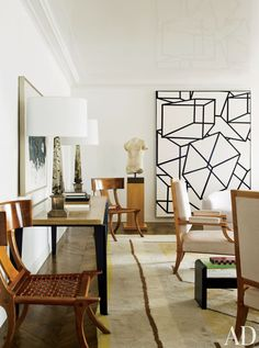 In the living room of a New York apartment by Delphine Krakoff the painting at right is Phoenicia VIII by Al Held.