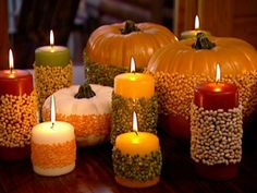 Split pea decorated pumpkin and candles | simply spray the surface with non-toxic glue and roll in assorted grains.