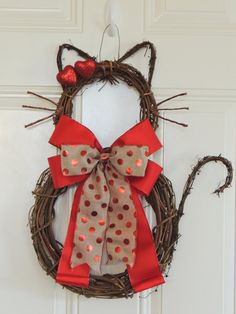 Grapevine Kitty Cat wreath. This wreath is shaping and assembling by me from start to finish. I made special edition for Valentines day with triple bow. The ribbon in the middle can be change to ribbon choices on the drop down menu. You can Style of the decoration on it and price