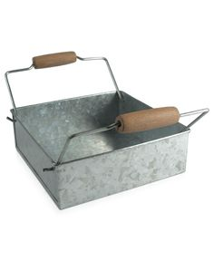 With a utilitarian design and undeniable charm, Artland's Oasis napkin holder fits right into sunny days around a picnic table and every barbecue bash. Galvanized tin with wooden accents gives any set