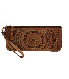 This gorgeous, hand-tooled leather wristlet is completely unique. Use it as the perfect weekend wristlet, clutch (detachable wristlet strap), or make-up bag! The glazed genuine hand-tooled leather wil