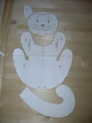 """Stuffed Cat Sewing Pattern   ... 12"""". Place pattern pieces onto the fabricand cut through both layers"""
