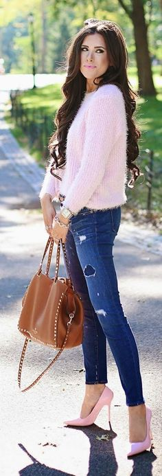 I like fuzzy sweaters. This pink number looks great with the distressed denim and pink high heels.