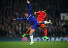 Eden Hazard of Chelsea and Marquinhos of PSG collide mid air during the UEFA Champions League Round of 16, second leg match between Chelsea and Paris Saint-Germain at Stamford Bridge on March 11, 2015 in London, England.