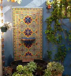 Outdoor fountain with Mexican tiles and succulents