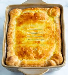 This spinach pie recipe is made with eggs, caramelized onions, gruyere cheese, and golden puff pastry. An easy side dish idea for Thanksgiving or a family dinner! Vegetable Quiche, Vegetable Side Dishes, Christmas Side Dishes, Spinach Pie, Gruyere Cheese, Side Dishes Easy, Comfortfood, Caramelized Onions, Golden Brown