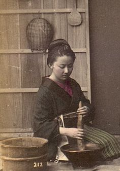 Detail. Four women preparing a meal.  Hand-colored image, 1909, Japan.