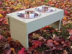 BRAND NEW, STAINLESS STEEL BOWLS ARE INCLUDED ( 2 QUART SIZE) As shown in the photo  FEEDER DIMENSIONS  10 inches tall  18.5 inches wide  10.5 inches deep  Finished in sea foam green