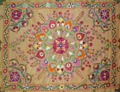 A Nurata suzani from the 1990s.  Silk embroidered on a cotton base.  Original source of image: EBay