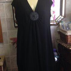 Apt 9 dress It's black with a metal design under middle breast of dress. Apt. 9 Dresses