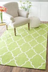 This Hand-made hooked area rug features a stylish contemporary look. Providing style, texture, and sophistication.