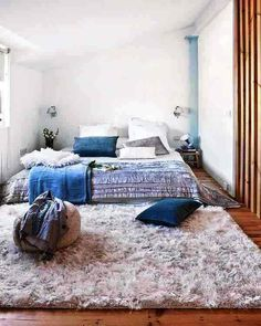 Bedroom:Teen Bedroom Interior Design Together With Luxury White Fury Rugs And Blue Cushions And Silver Bedding Also White Pillows Plus Wall Lamps In White Walls As Well As Wooden Floor Ideas For Small Bedroom Interior De The Amazing Modern Bedroom Interior Design Ideas For Your New Apartment