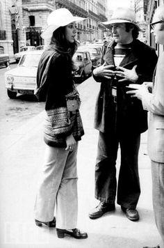 Marisa Berenson and Dennis Hopper on the street.