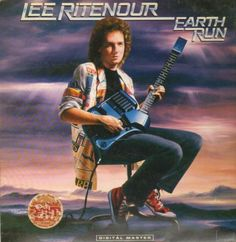Lee Ritenour holding a SynthAxe on the cover of his album, Earth Run