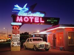 1949 Chrysler Windsor at Blue Swallow Motel on Route 66 in Tucumcari, New Mexico - Car Culture/Car Culture ® Collection/Getty Images Blue Swallow Motel, Driving Route 66, Route 66 Road Trip, Chrysler Windsor, Naming Your Business, National Geographic Travel, New Mexico, Mexico Art, The Good Old Days
