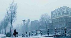 Take a Mesmerizing Coffee Break: Go For a Virtual Walk Through Snowy Amsterdam