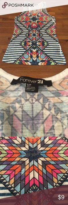 Geometric Forever 21 Tank Top Size small Forever 21 tank top. Geometric design. Multiple colors include white, blue, orange, yellow, pink, and purple. True to size. Razor back. 88% polyester and 12% rayon. Smoke free home. Forever 21 Tops Tank Tops
