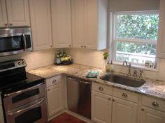 White kitchen and granite counter tops... idea for Jason's kitchen redo.