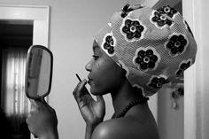 Nigeria girl applying makeup